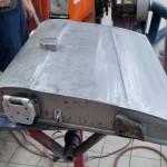 Door skin repair panel that fits